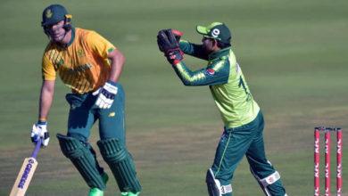 Pakistan´s Mohammad Rizwan (R) catches a ball as South Africa´s Pite van Biljon (L) runs between the wickets during the first Twenty20 international cricket match between South Africa and Pakistan at the Wanderers stadium in Johannesburg on April 10, 2021. — AFP