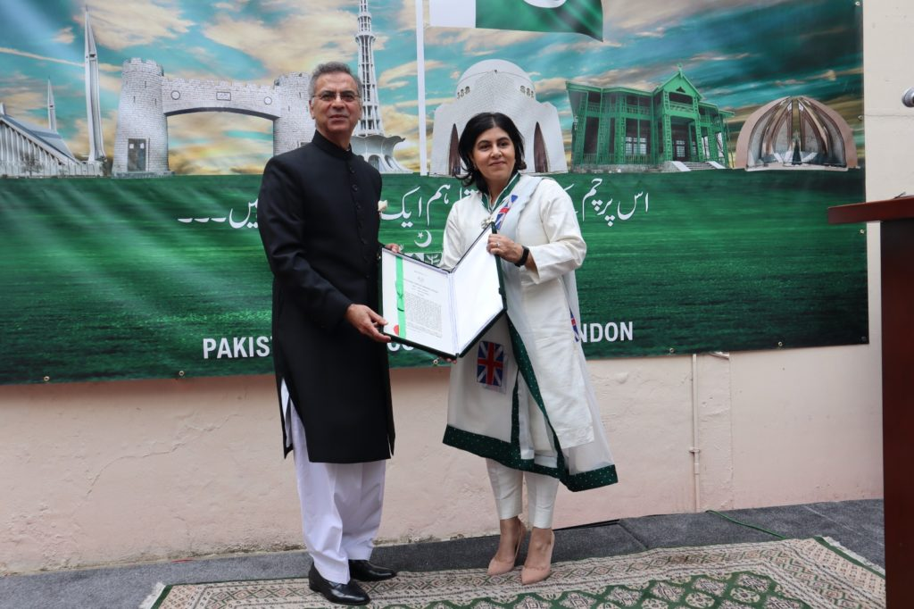 Pakistan High Commissioner to the UK, Moazzam Ahmad Khan conferring Sitara-e-Pakistan on Baroness Sayeeda Warsi at the Independence Day ceremony at Pakistan High Commission London