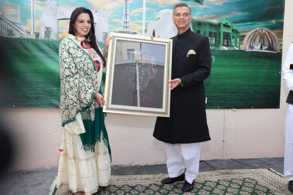 Amina Ansari artist presenting Quaid-i-Azam's portrait to the High Commissioner at Independence Day ceremony